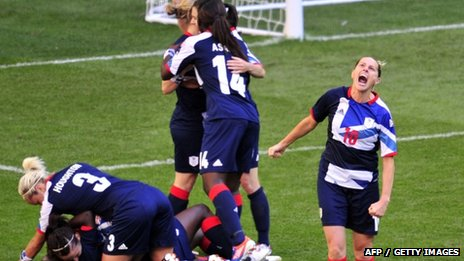 Britain&#039;s striker Kelly Smith (R) celebrates midfielder Jill Scott scoring the second goal against Cameroon