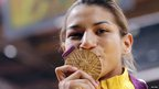 Brazil's Sarah Menezes gives her gold medal as kiss.