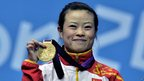 Wang Mingjuan from China took home gold in the 48 kilogram women's weightlifting.