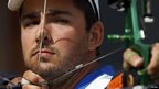 Italian player setting up during archery event.