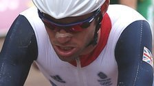 Mark Cavendish grimaces as he crosses the finishing line in the road race