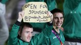 Paddy Barnes holds aloft his sign at the Olympic Open Ceremony alongside team-mate Michael Conlon