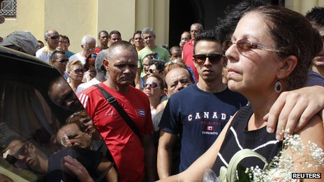 Ofelia Acevedo, wife of Cuban activist Oswaldo Paya, mourns at a procession for his burial in Havana