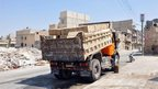 "Lorry loaded with boxes labelled ""gas masks"" in Arabic outside rebel base in Aleppo (25 Jul)"