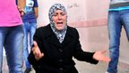 Mother of man allegedly killed by Syrian government sniper mourns over his body in Aleppo (25 July)