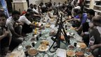 "Rebels in Aleppo break their Ramadan fast with an ""iftar"" meal (24 July)"