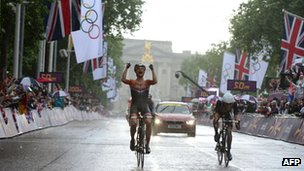 Marianne Vos celebrates as she crosses the finish, followed by Lizzie Armitstead