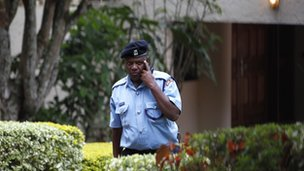 A police officer leaves the residence of the acting Ambassador, Olga Fonseca