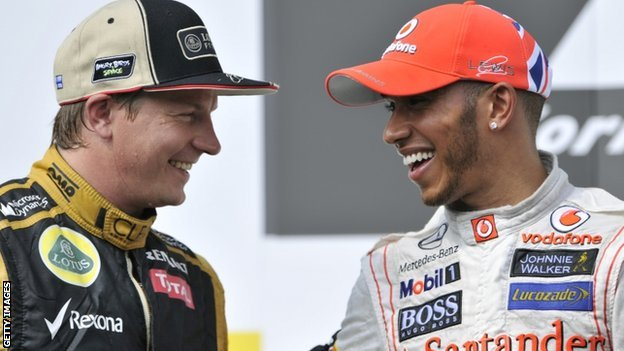 Lewis Hamilton (right) and second placed Kimi Raikkonen