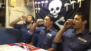 "Submariners receive their ""dolphins"" insignia by swallowing a glass of rum"