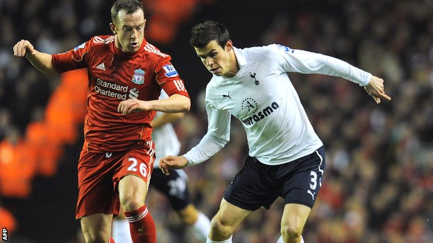 Charlie Adam (left) tussles with Gareth Bale in a league match at Anfield in February