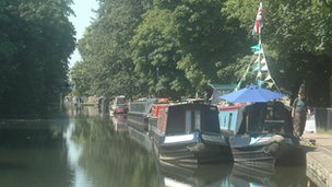Boats moored along Regents Canal