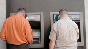 Customers use cash machines