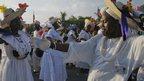Haitian voodoo worshippers dancing in Port-au-Prince on 29 July 2012