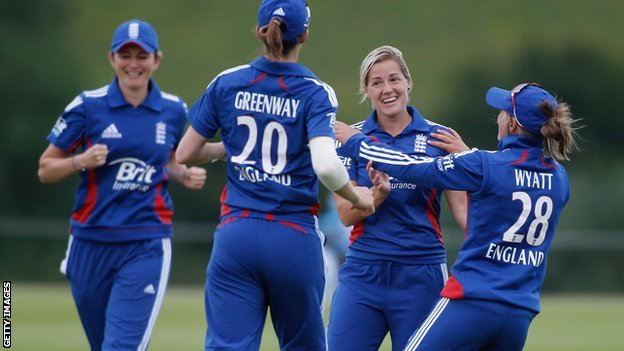 England celebrate a wicket by Katherine Brunt (second right)