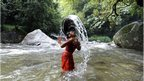 A Hindu devotee takes a dip in the Bagmati River