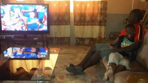 Gabriel Asiamah and his sister watching London 2012 on TV in West Africa 
