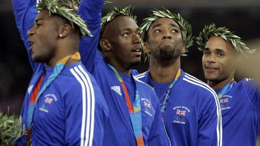 Sprinter Darren Campbell on the medals podium with his relay team-mates