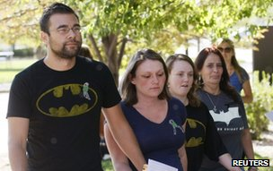 Victims and family of victims wearing Batman clothes arrive for the second court appearance of James Holmes, in Centennial, Colorado on 30 July 2012