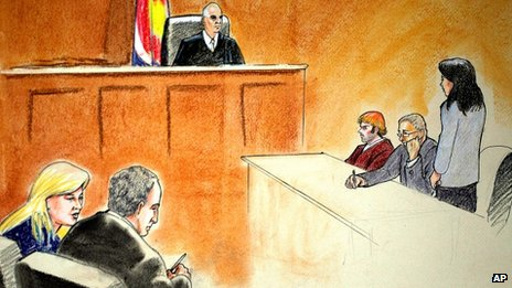 In this courtroom sketch, suspect James Holmes, third from right, sits in district court 30 July 2012, in Centennial, Colorado