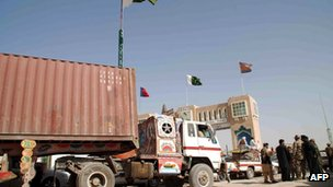 NATO supply trucks drive toward the border terminal in Chaman on July 17, 2012.