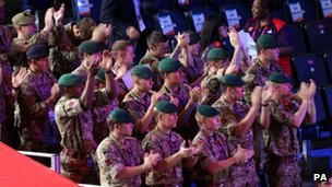 Soldiers clapping at the boxing