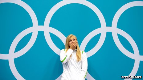 A shocked Ruta Meilutyte waits to receive her gold medal