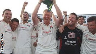 Lancashire captain Glen Chapple lifts the County Championship trophy