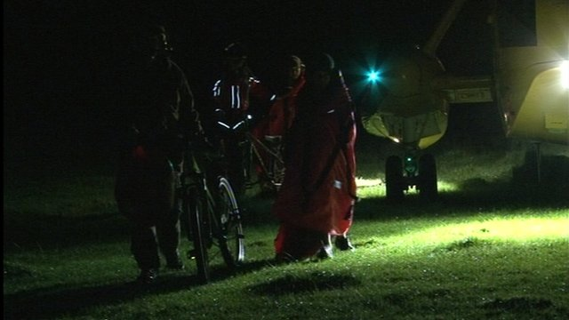 Children are escorted from an RAF search and rescue helicopter