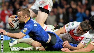 Rob Burrow scores a try for Leeds against St Helens in the 2011 Grand Final at Old Trafford