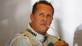 Michael Schumacher looks on in Hungary