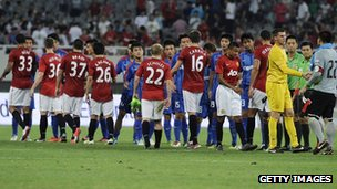 Manchester United line up against China's Shanghai Shenhua
