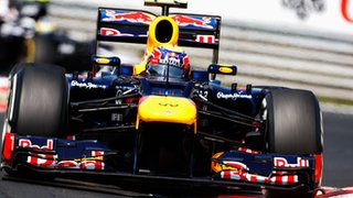 Mark Webber races for Red Bull