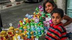Dalya and her brother by her stall, selling lanterns, or fawanees, in Gaza&#039;s old quarter