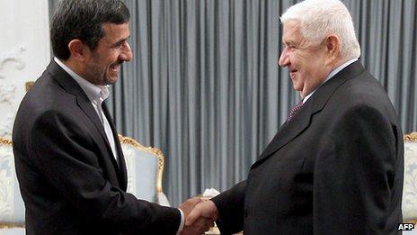 Mahmoud Ahmadinejad and Walid al-Muallem