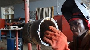 Tobine working on a pipe