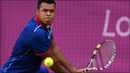 Jo-Wilfried Tsonga in action against Milos Raonic