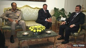 US Defence Secretary Leon Panetta (c) meets Egyptian President Mohammed Mursi (r) the head of Egypt's ruling military council, Field Marshal Mohammed Hussein Tantawi (l), in Cairo on 31 July 2012