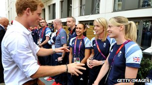 Prince Harry chats to athletes including Jessica Ennis and Nicola Sanders at the Olympic Village