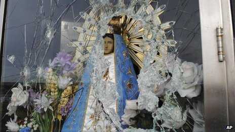 Image of Virgin Mary behind shattered glass near Darwin in the Falklands (Picture released by Commission of Families of Fallen soldiers 30 Jul 2012)