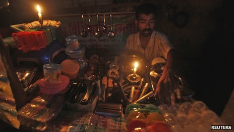 A shop owner during a power cut in Calcutta, India