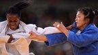 France's Gévrise Emane competes with Mongolia's Munkhzaya Tsedevsuren