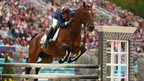 Nicolas Touzaint of France riding Hildago de L'ile in action in the show jumping equestrian even