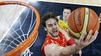 Pau Gasol of Spain lays up a shot as he breaks past Aron Baynes of Australia