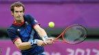 Andy Murray returns a shot to Jarkko Nieminen of Finland