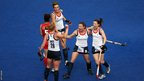 Nicola White of Great Britain celebrates scoring with her team-mates