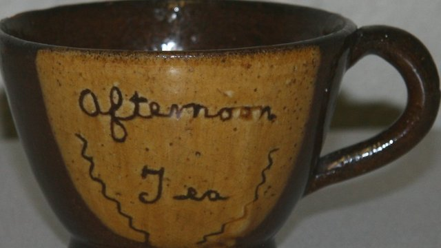 Tea cup made by Hughes Pottery