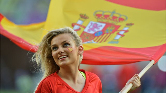 Cheerleader waves Spanish flag ahead of a Euro 2012 match