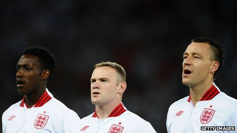 Danny Welbeck, Wayne Rooney and John Terry of England sing the national anthem ahead of the UEFA EURO 2012 quarter final match between England and Italy at The Olympic Stadium on June 24, 2012 in Kiev, Ukraine