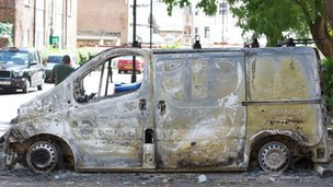 A burnt out van on Tottenham High Road, in London, on 7 August 2011